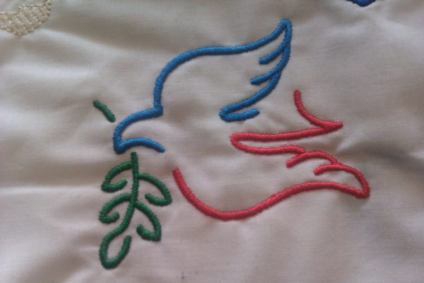 two colour dove with leaf
